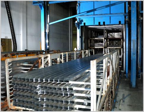 newly extruded aluminium extrusions racked for heat treatment process