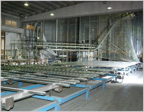 profiles being raised into vertical powder coating painting plant